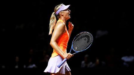 Petenis asal Rusia, Maria Sharapova merayakan kemenangan. - INDOSPORT