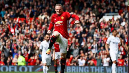 Wayne Rooney melakukan selebrasi. - INDOSPORT