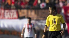 Indosport - Pelatih Madura United, Rasiman sempat memberikan sindiran keras terhadap wasit Thoriq Alkatiri yang memimpin laga Liga 1 kontra Persija Jakarta.