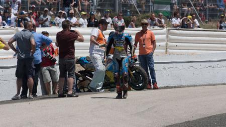Ekspresi kekecewaan Jack Miller setelah gagal finish di MotoGP Spanyol. - INDOSPORT