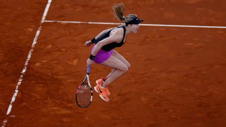 Ekspresi kemenangan Eugenie Bouchard saat mengalahkan Maria Sharapova di Madrid Terbuka. - INDOSPORT