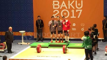 Cabang olahraga angkat besi Indonesia berhasil meraih tiga medali emas dalam ajang Islamic Solidarity Games 2017. - INDOSPORT