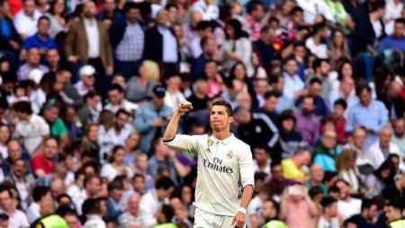 Selebrasi Cristiano Ronaldo saat membobol gawang Sevilla. - INDOSPORT