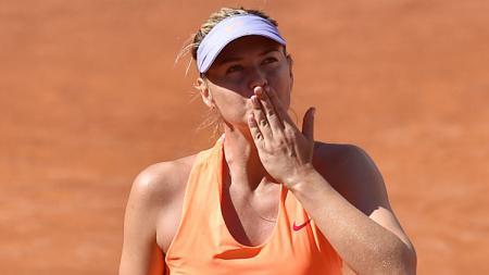 Maria Sharapova melakukan selebrasi. - INDOSPORT