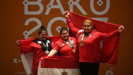 Nurul Akmal (kiri) meraih medali perak di ajang Islamic Solidarity Games 2017. - INDOSPORT