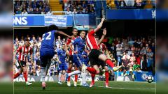 Indosport - Duel antara pemain Chelsea melawan Sunderland.