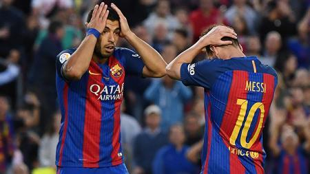 Kepergian Luis Suarez ke Atletico Madrid bisa menjadi pemicu Lionel Messi bakal menjadi 'bom bunuh diri' yang bisa menghancurkan Barcelona. - INDOSPORT