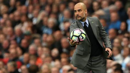 Pep Guardiola merasa Manchester City masih punya banyak pekerjaan rumah jelang lawan Schalke. - INDOSPORT