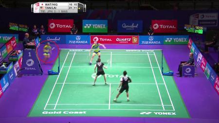 Aksi pasangan ganda campuran Malaysia saat menghadapi wakil Jepang. - INDOSPORT
