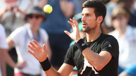 Novak Djokovic menghadapi Kei Nishikori di perempatfinal Australia Terbuka 2019. - INDOSPORT
