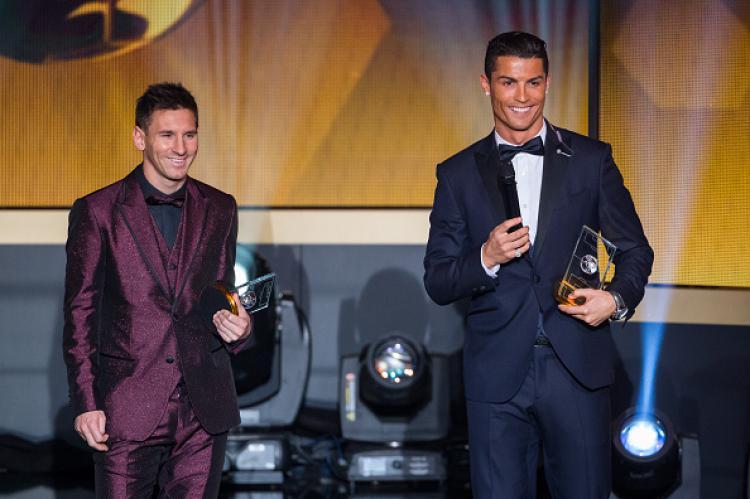 Cristiano Ronaldo dan Lionel Messi dalam gala dinner Ballon d Or di tahun 2015 lalu. Copyright: Philipp Schmidli/Getty Images