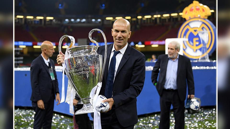 Pelatih Real Madrid, Zinedine Zidane sukses mengantarkan tim besutannya juara Liga Champions 2016/17. Copyright: INDOSPORT