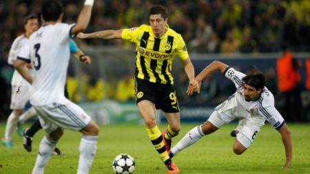 Robert Lewandowski saat masih membela Borussia Dortmund sempat permalukan Real Madrid di Liga Champions 2012-2013. - INDOSPORT