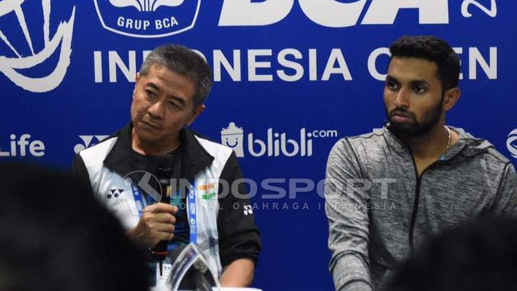 Prannoy Haseena Sunil Kumar dan Mulyo Handoyo. Copyright: Herry Ibrahim/Indosport.com