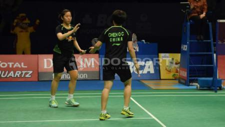 Keberhasilan ganda putri China, Chen Qing Chen/Jia Yi Fan, melaju ke babak final Denmark Open 2019  membuat mereka menorehkan prestasi manis di ranking BWF. - INDOSPORT