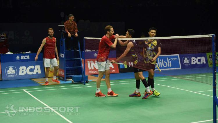 Mathias Boe/Carsten Mogensen usai pertandingan lawan Fajar/Rian. Copyright: Herry Ibrahim/INDOSPORT