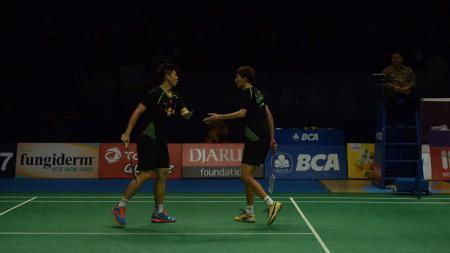 Pasangan ganda putra Li Junhui/Liu Yuchen lagi-lagi harus bertekuk lutut di hadapan ganda putra India, kali ini di Fuzhou China Open 2019. - INDOSPORT