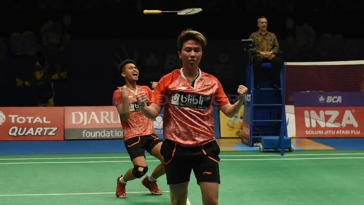 Tontowi Ahmad/Liliyana Natsir merayakan kemenangan di final Indonesia Open 2017. Copyright: Herry Ibrahim/Indosport.com