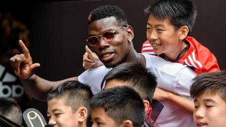 Paul Pogba ketika sedang liburan ke China. - INDOSPORT