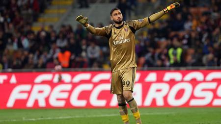 Kiper AC Milan, Gianluigi Donnarumma, menjadi buruan teratas Atletico Madrid akibat Paris Saint-Germain hendak membajak kiper nomor satu mereka, Jan Oblak. - INDOSPORT