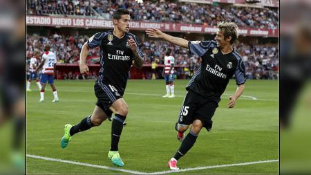 James Rodriguez dan Fabio Coentrao (kanan), dua pemain bintang Real Madrid. - INDOSPORT