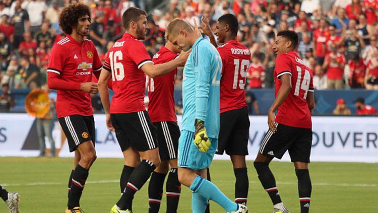 Selebrasi pemain Manchester United setelah Marcus Rashford cetak gol. Copyright: INDOSPORT