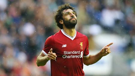 Mohamed Salah melakukan selebrasi. - INDOSPORT