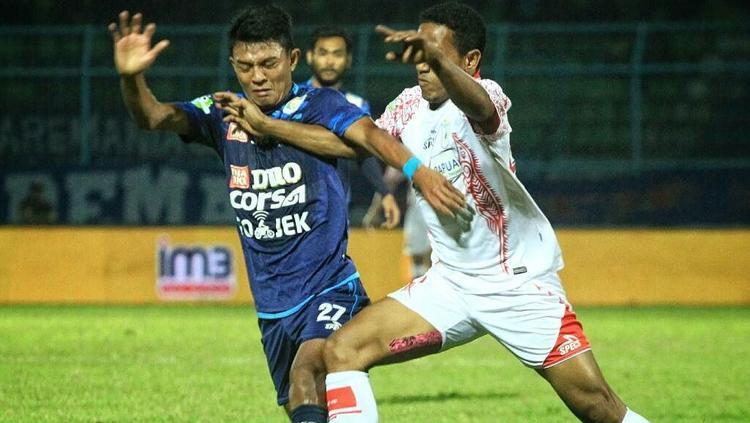 Persipura bungkam perlawanan Arema FC. Copyright: wearemania.net