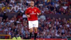Indosport - Eric Cantona saat membela Manchester United.