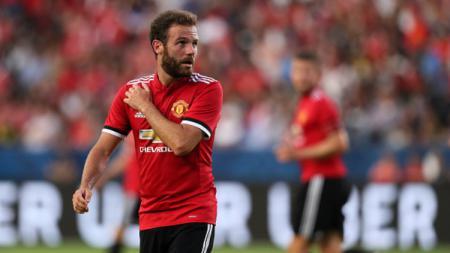 Gelandang Manchester United, Juan Mata, mengungkapkan isi hati setelah timnya tidak meraih hasil baik pada musim 2018/19. Matthew Ashton - AMA/Getty Images. - INDOSPORT