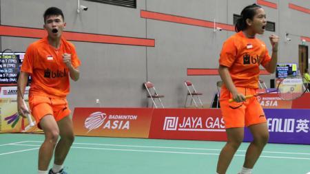 Rinov Rivaldy/Siti Fadia merayakan kemenangan. - INDOSPORT