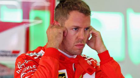 Sebastian Vettel, pembalap Ferrari, tak terima dirinya mendapat penalty dari Stewards dalam balapan Formula 1 di GP Kanada 2019. - INDOSPORT