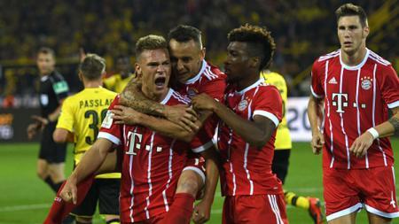 Selebrasi para pemain Bayern Munchen usai mencetak gol ke gawang Dortmund. - INDOSPORT