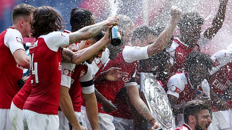 Kegembiraan pemain Arsenal juara Community Shield 2017. Copyright: INDOSPORT