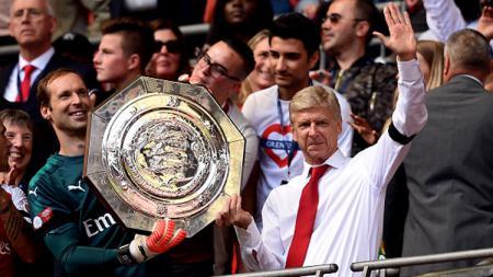 Arsene Wenger merupakan sosok pelatih legendaris yang telah mendedikasikan banyak waktunya menangani Arsenal. - INDOSPORT