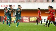 Indosport - Selebrasi pemain PSS Sleman.