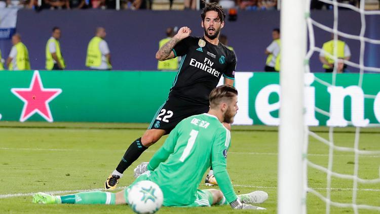 Momen Isco berhasil mencetak gol ke gawang David De Gea. Copyright: INDOSPORT