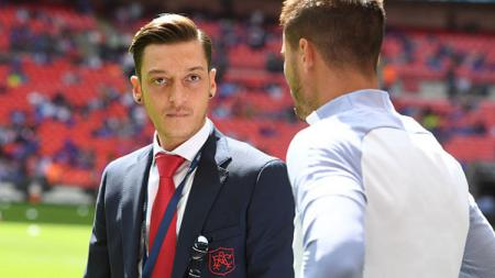 Mesut Ozil (kiri), playmaker Arsenal. - INDOSPORT