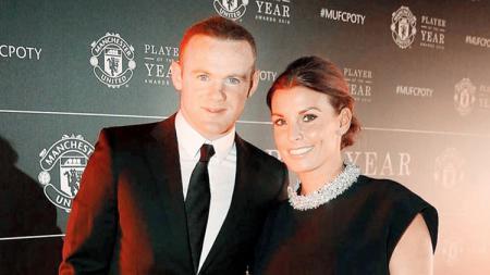 Wayne Rooney bersama sang istri, Coleen. - INDOSPORT