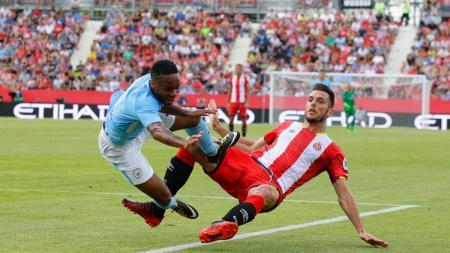 Sterling ditekel pemain Girona FC. - INDOSPORT