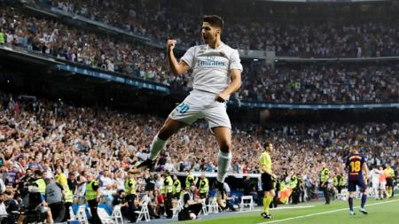 Selebrasi Asensio usai cetak gol ke gawang Barcelona. - INDOSPORT