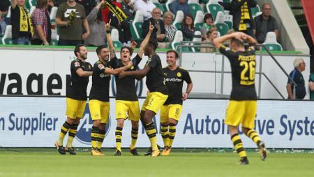 Christian Pulisic selebrasi usai mencetak gol untuk Borussia Dortmund. - INDOSPORT