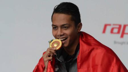 I Gede Siman Sudartawa di podium SEA Games 2017. - INDOSPORT