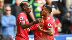 Indosport - Paul Pogba dan Anthony Martial.
