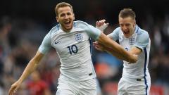 Indosport - Harry Kane dan Jamie Vardy, dua striker Timnas Inggris.