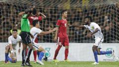 Indosport - Thanabalan Nadarajah (Malaysia) saat menjebol gawang Timnas Indonesia U-22 di semifinal SEA Games 2017 (26/8/17).