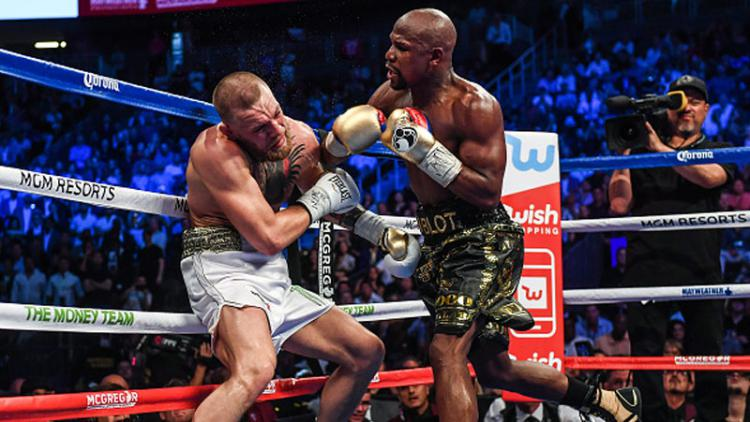Floyd Mayweather Jr vs Conor McGregor. Copyright: Indosport.com