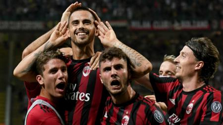 Para pemain AC Milan merayakan gol yang dicetak oleh Suso. - INDOSPORT