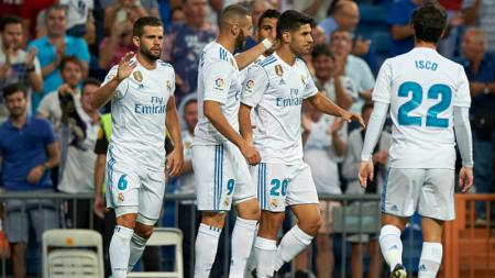 Marco Asensio merayakan golnya yang pertama bersama rekan-rekannya. - INDOSPORT