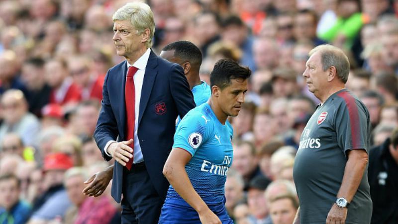 Alexis Sanchez digantikan oleh Olivier Giroud di menit 62. Copyright: INDOSPORT